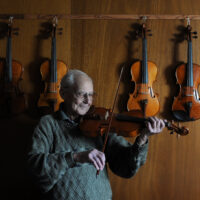 Frank Hurford/Seniors profile  Photo Mike Wakefield/ Mar17/10/  Surrounded by his creations,Frank has been building + creating Violins for decades/Seniors