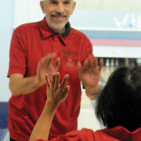 NS Bowl3 Special Olympians   Mar 22-18 Gary Jones high fives a teammate during play. photo Mike Wakefield